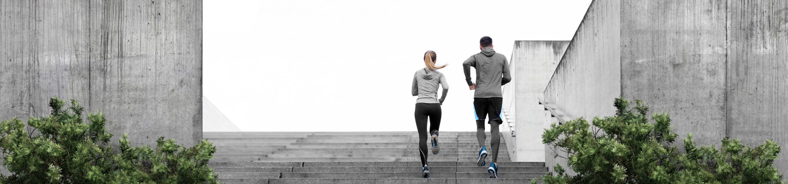 Strength Tek man and woman running on stairs, banner
