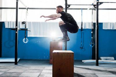 Strength Tek man jumping on boxes